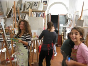 Students painting in the studio